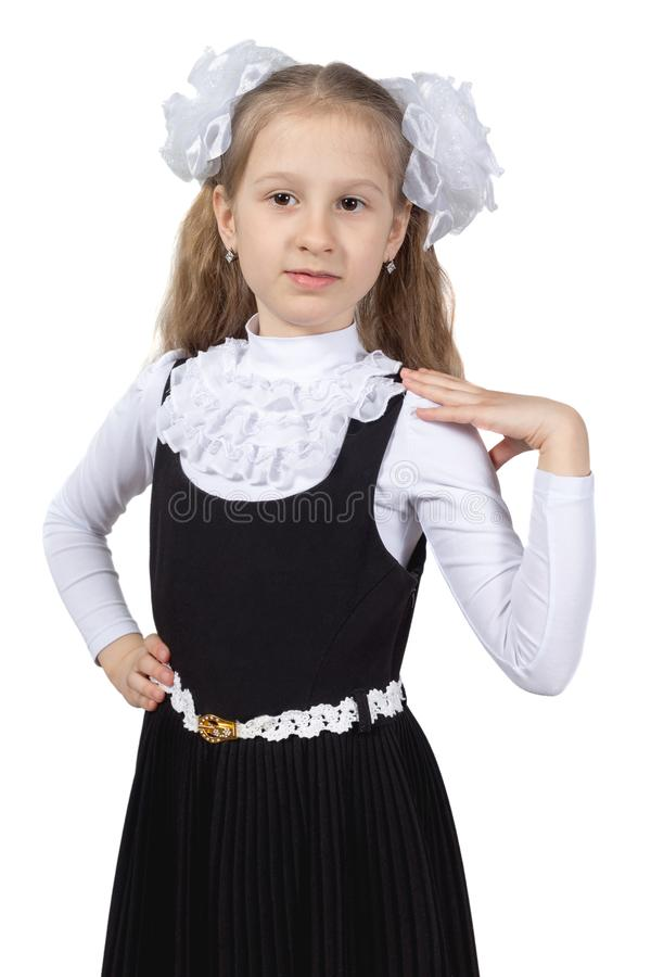 Немногое милая школьница представляя на белой предпосылке стоковые фото