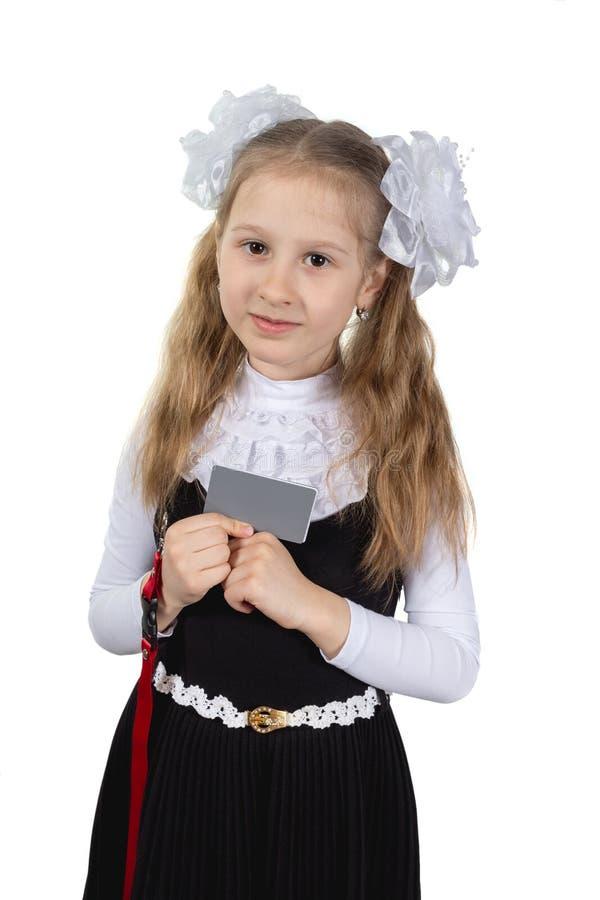 Немногое милая школьница представляя на белой предпосылке стоковое изображение rf