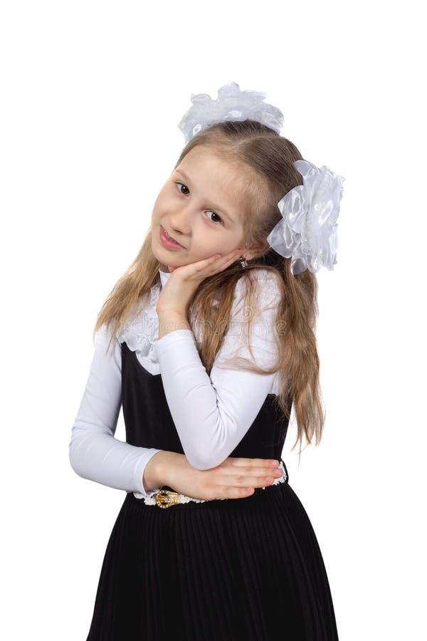 Немногое милая школьница представляя на белой предпосылке стоковые изображения