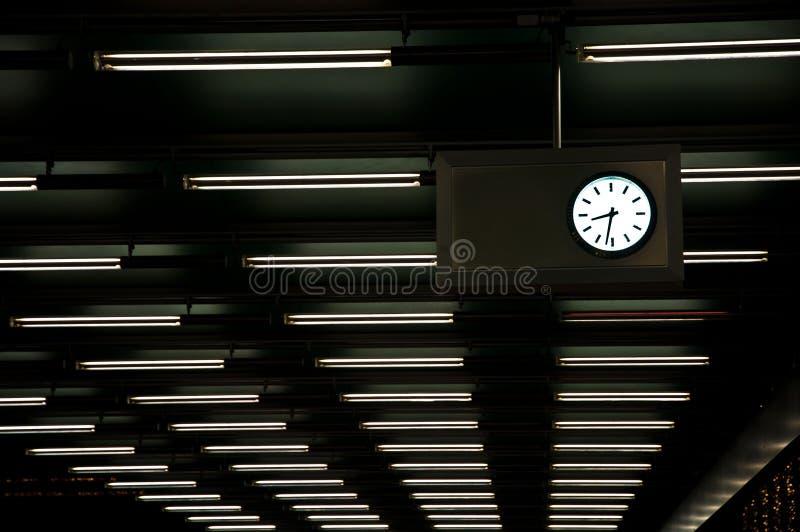 Неоновое свето часа и стоковые изображения