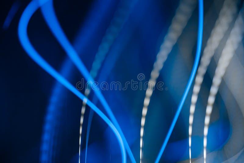 Неоновые голубые света в mowement иллюстрация вектора