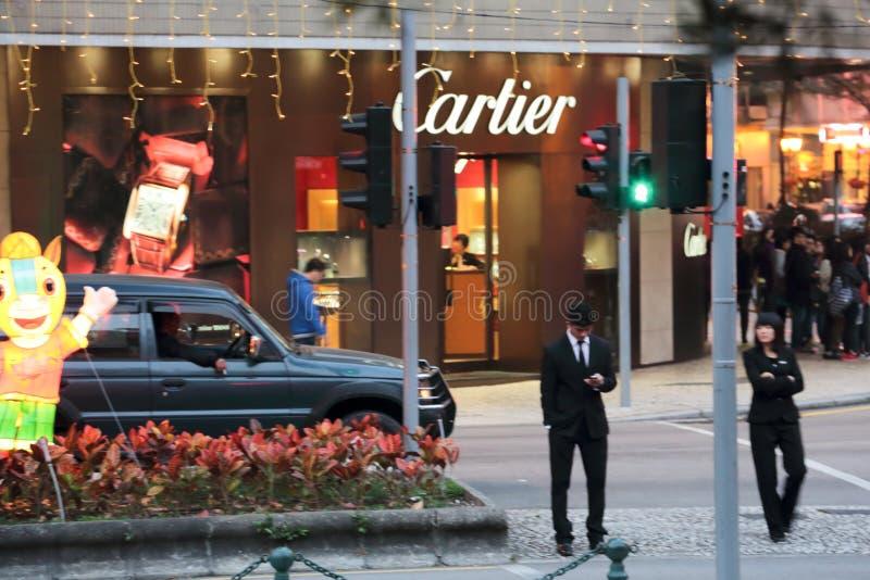 Неоновые света Cartier рекламируя в улице в Макао стоковые изображения rf
