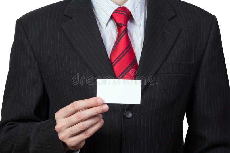 Непознаваемый бизнесмен держа карточку в руке стоковые изображения