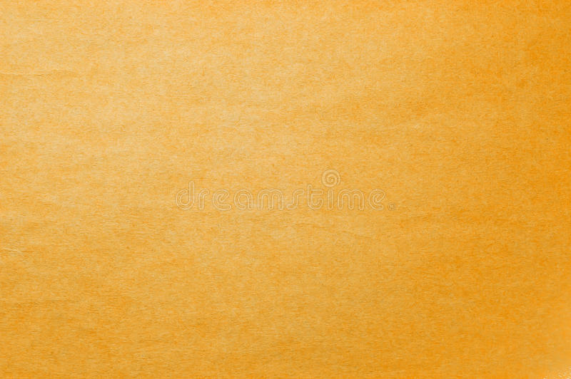 Непрозрачная желтая предпосылка с светом облупленным стоковое фото