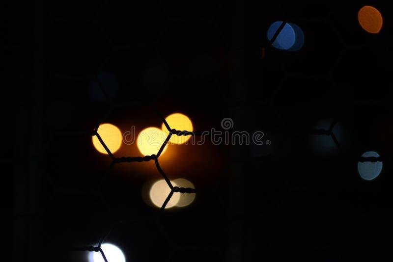 Нерезкость освещает за решеткой стоковое фото rf