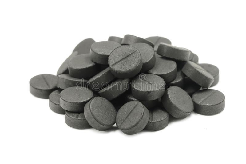 Несколько таблеток активированного угля стоковые изображения
