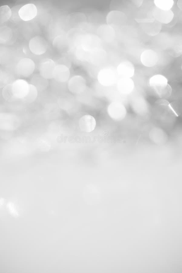 Несосредоточенная абстрактная серебряная предпосылка праздника яркого блеска стоковые фото