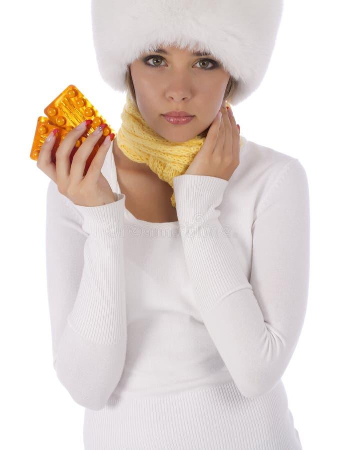 Несчастная девушка держащ таблетки в ее руке стоковое фото rf