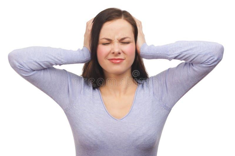 Несчастная женщина покрывая ее уши стоковые изображения rf