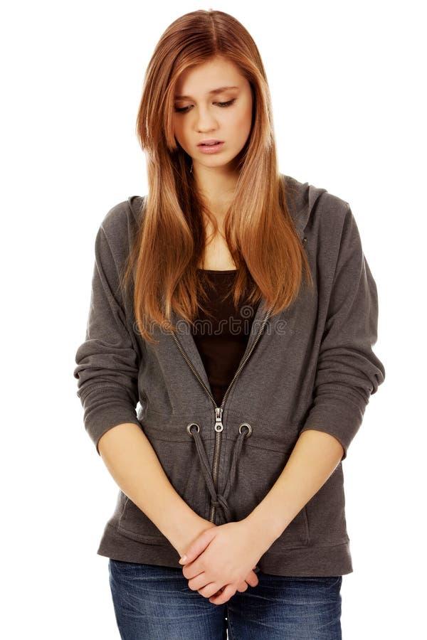 Несчастная и заботливая подростковая женщина стоковые изображения rf