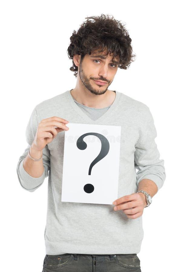 Неуверенный человек показывая знак вопросительного знака стоковые изображения rf