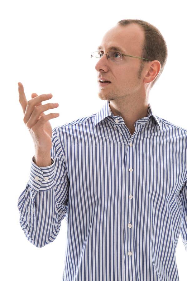 Недостаток понимать: изолированный человек в сини смотря stunned сторону стоковые фотографии rf