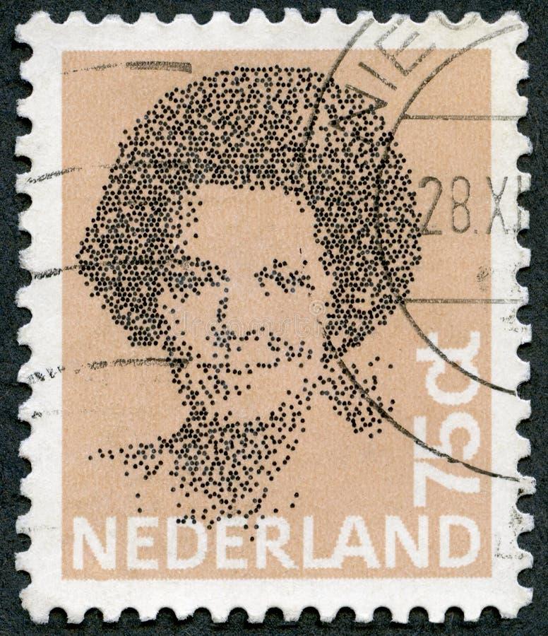 НИДЕРЛАНДЫ - 1981: ферзь Beatrix выставок, черная виньетка стоковое фото rf