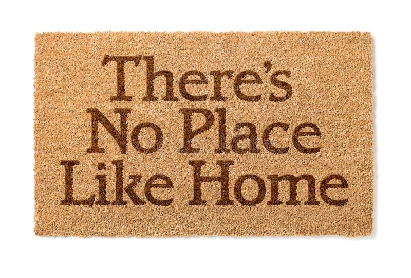 Никакое место как домашняя радушная циновка на белизне стоковая фотография