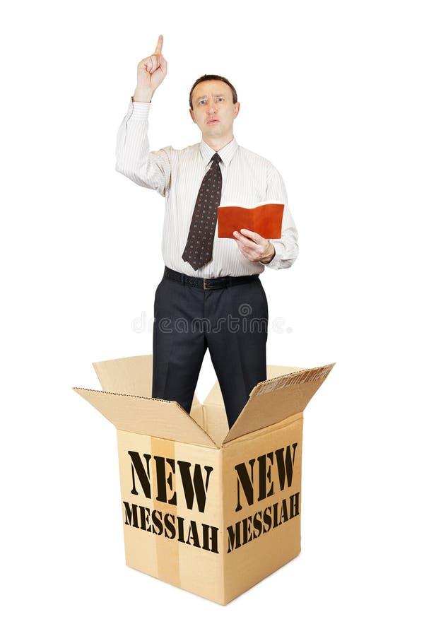 Новая мессия перескакивает вне от картонной коробки и говорит стоковые изображения rf