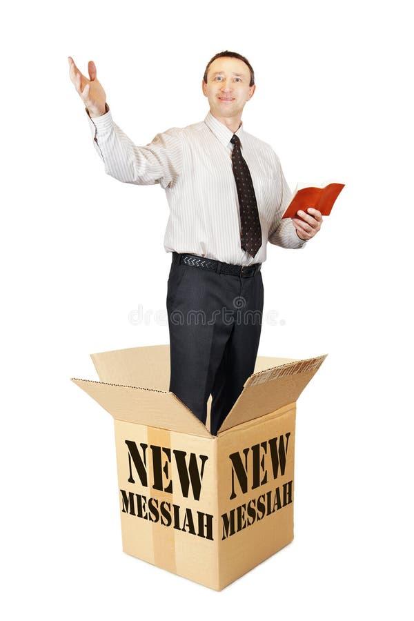 Новая мессия перескакивает вне от картонной коробки и проповедует стоковое изображение rf