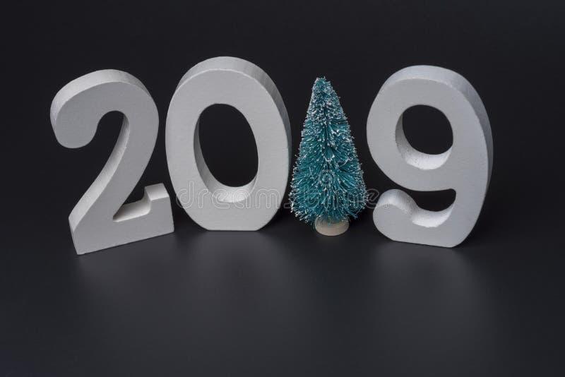 Новый Год две тысячи 19, белые номера на черной предпосылке стоковая фотография rf
