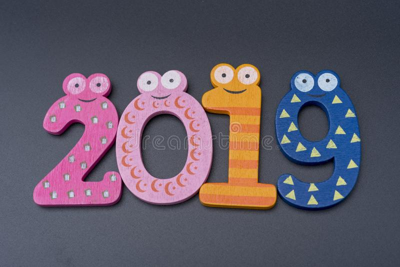 Новый Год две тысячи 19, белые номера на черной предпосылке стоковое фото rf