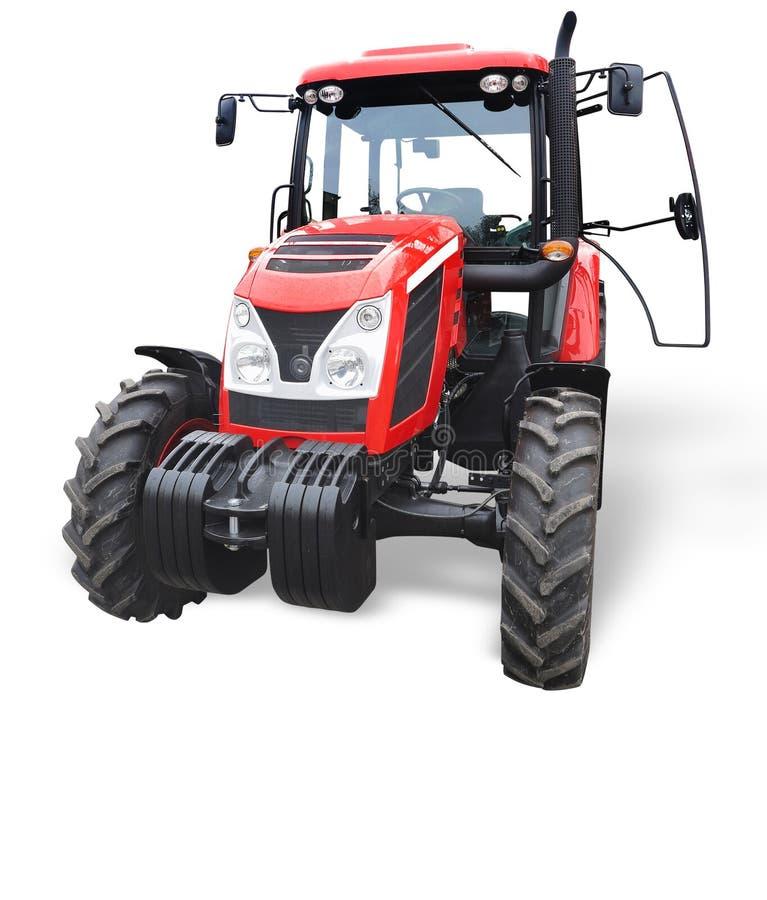 Новый красный мощный трактор изолированный над белизной стоковая фотография
