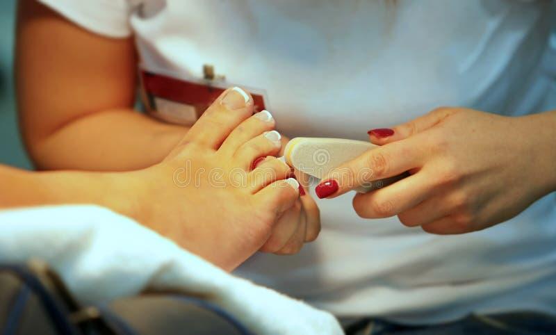 Нога заботы ногтя стоковое изображение rf