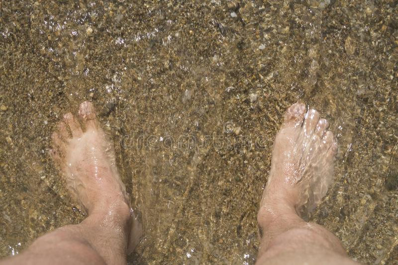 Feet in seawater. royalty free stock photography