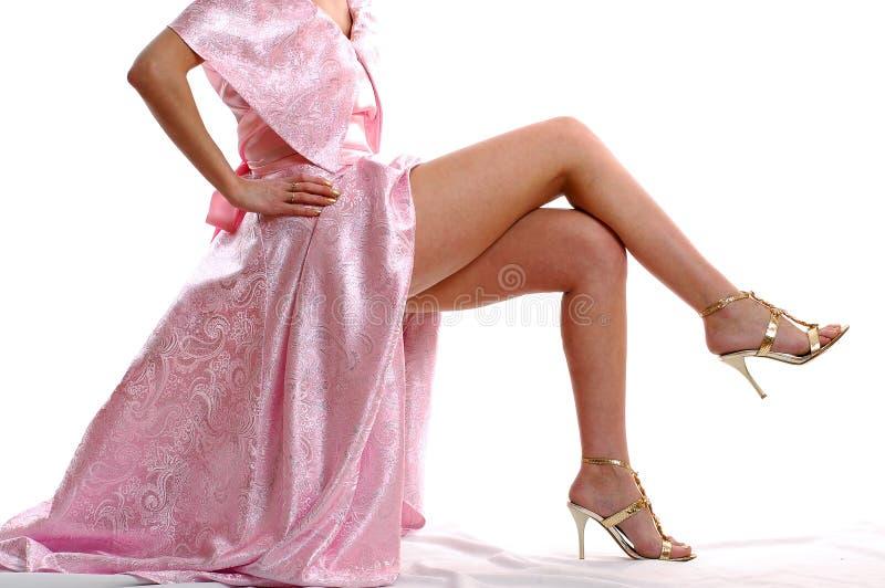 ноги девушок предпосылки белые стоковые фотографии rf