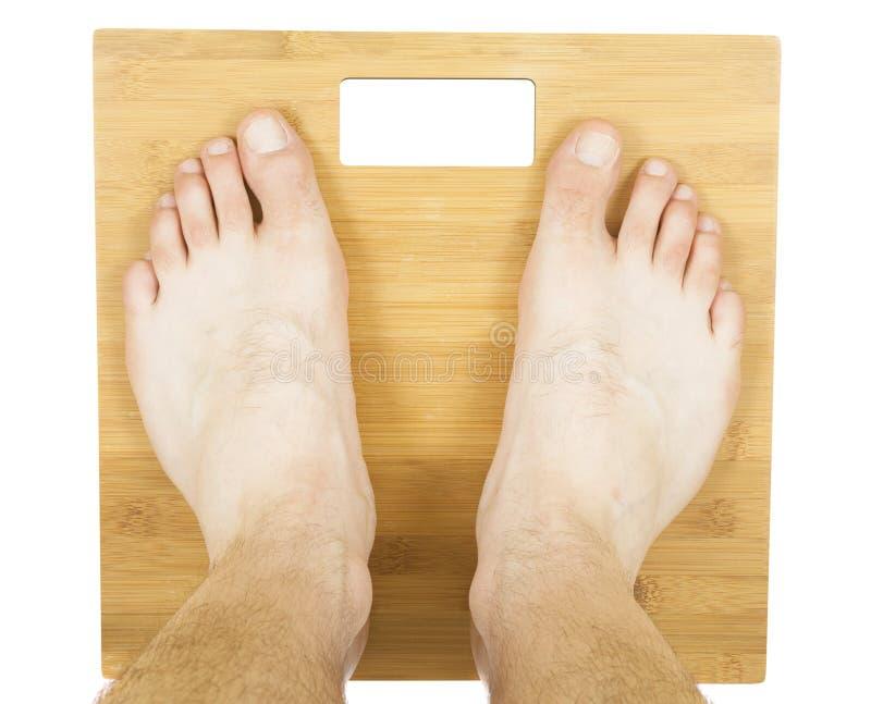 Ноги человека на масштабе стоковое фото