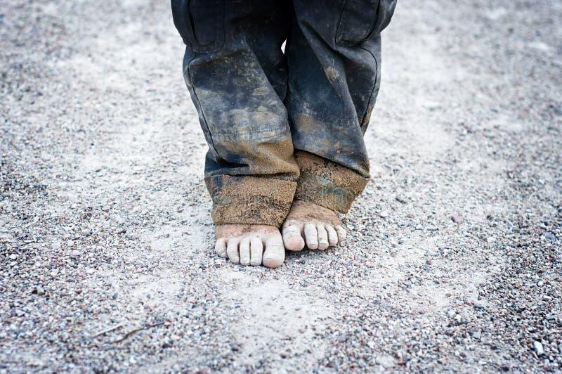 ноги s ребенка пакостные стоковое фото rf