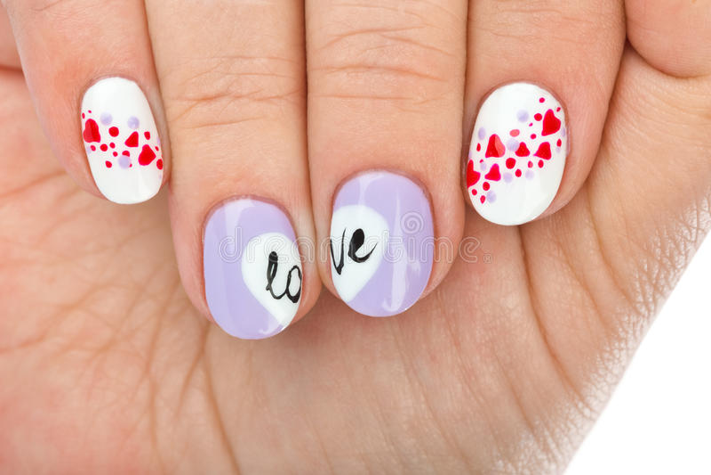 Ноготь пальца с картиной влюбленности стоковое фото