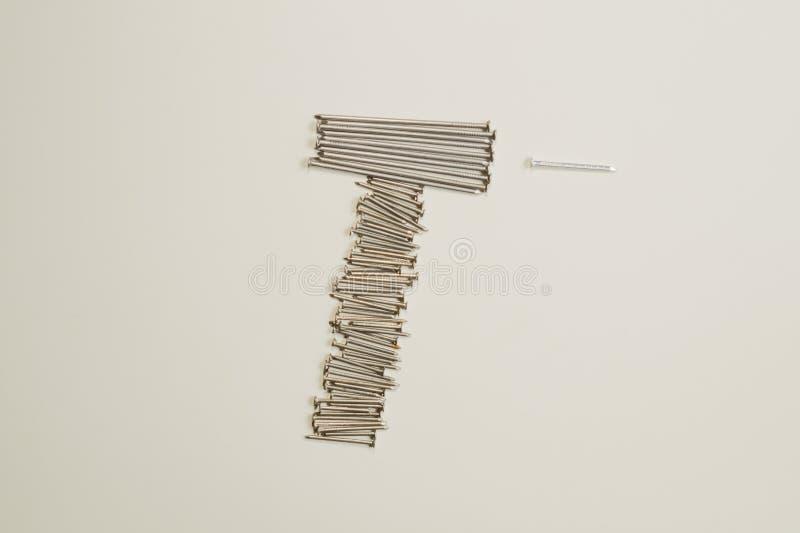 Ногти металла изолированные на белой предпосылке инструменты деятельности стоковое фото