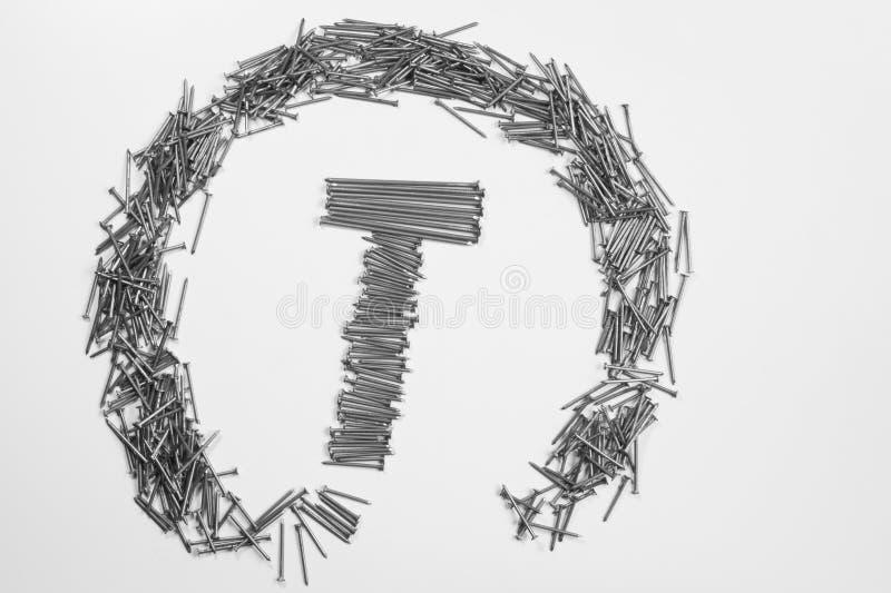 Ногти металла изолированные на белой предпосылке инструменты деятельности стоковое изображение