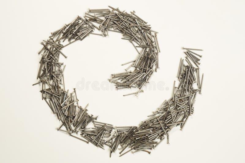 Ногти металла изолированные на белой предпосылке инструменты деятельности стоковое фото rf