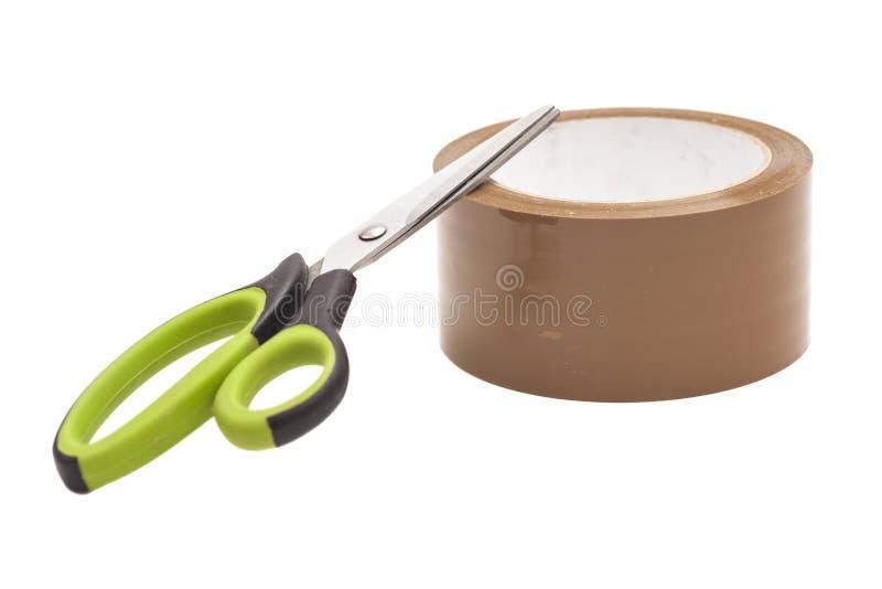 Ножницы и крен клейкая лента для герметизации трубопроводов отопления и вентиляции стоковые фото
