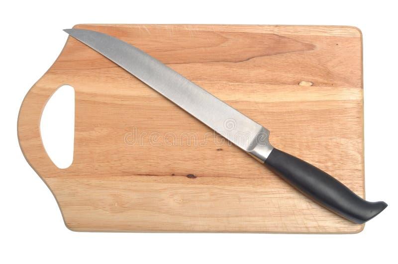 нож для разрезания доски стоковое фото rf
