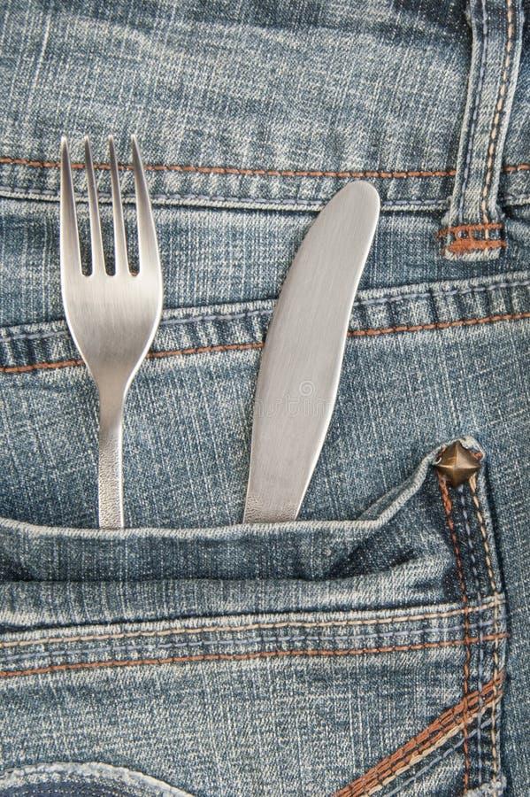 Нож и вилка в карманн стоковые изображения rf