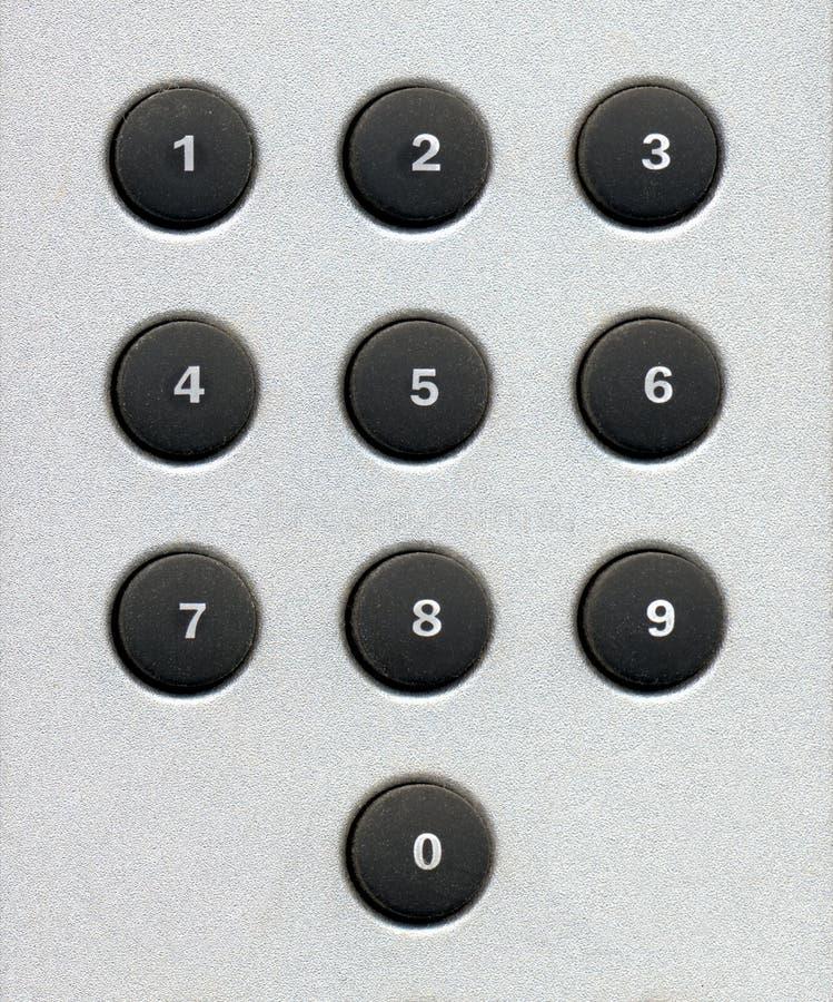номер застегивает кнопочную панель стоковые фото