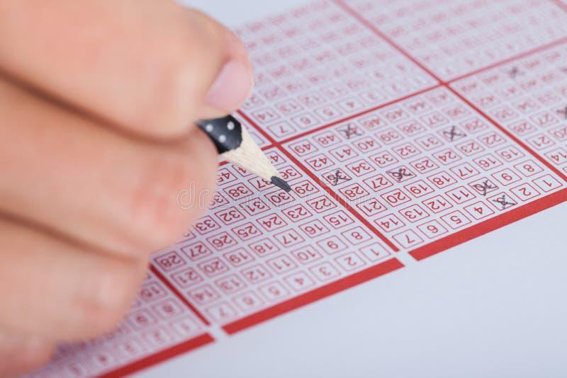 Номер маркировки персоны на билете лотереи стоковое изображение rf