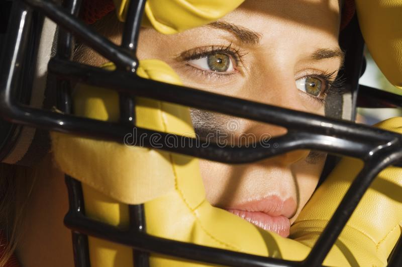 носить софтбола игрока шлема стоковое изображение rf