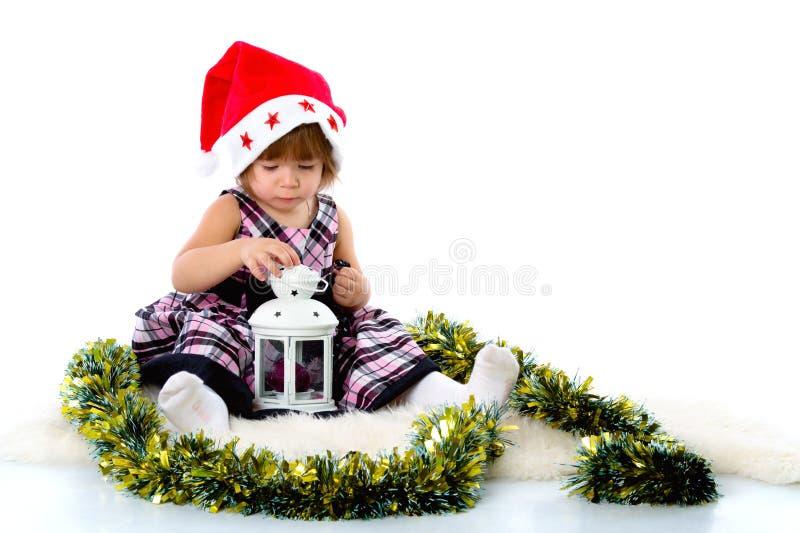 носить santa шлема девушки маленький стоковая фотография