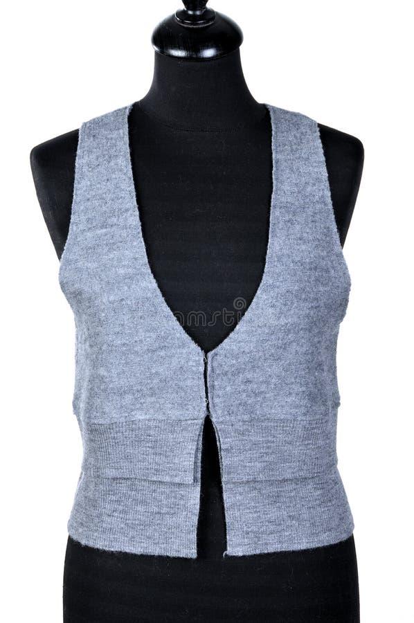 Носка ` s женщины - безрукавный пуловер Связанный жилет изолированный на белой предпосылке стоковые изображения rf