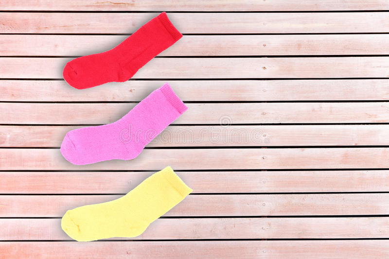 носок на деревянной предпосылке стоковая фотография