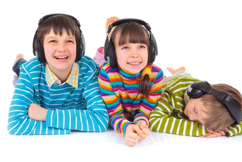 нот детей слушая к стоковое фото rf
