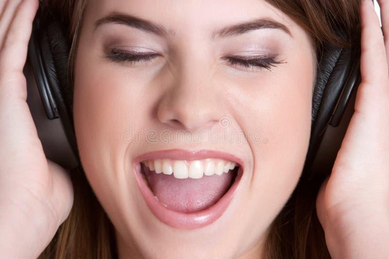 нот наушников девушки стоковое изображение