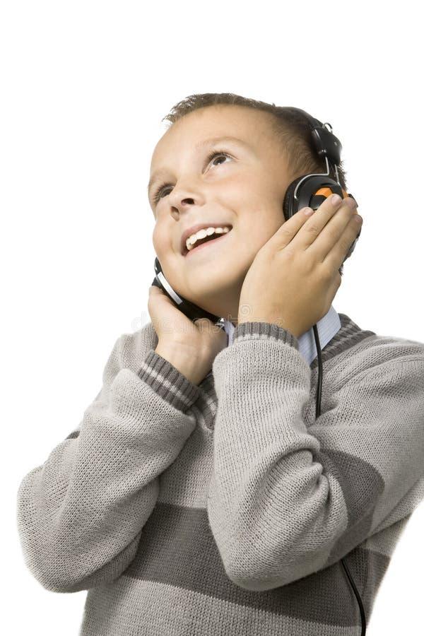 нот ребенка счастливое слушая к стоковая фотография rf