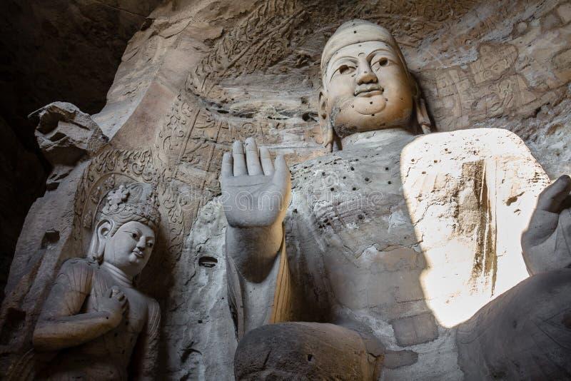 Ноябрь 2014, Datong, Китай: Статуя Будды на гротах Yungang в Datong, Китае стоковое изображение rf