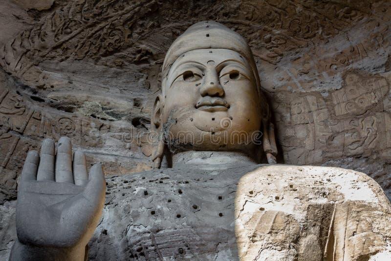 Ноябрь 2014, Datong, Китай: Статуя Будды на гротах Yungang в Datong, Китае стоковое фото