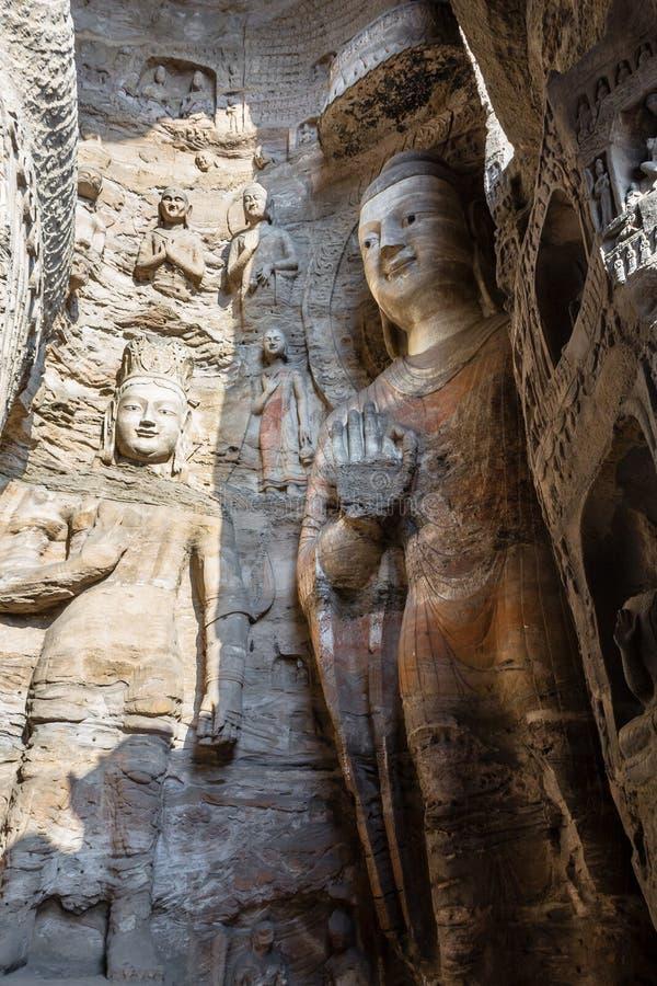 Ноябрь 2014, Datong, Китай: Статуя Будды на гротах Yungang в Datong, Китае стоковая фотография