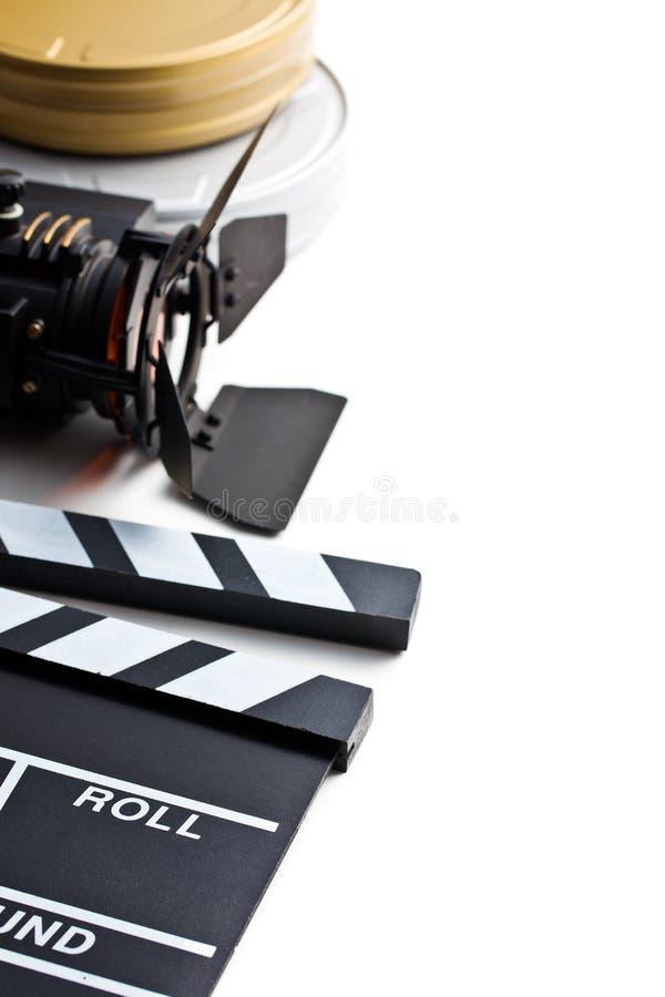 Нумератор с хлопушкой с вьюрком света и фильма кино стоковое изображение rf
