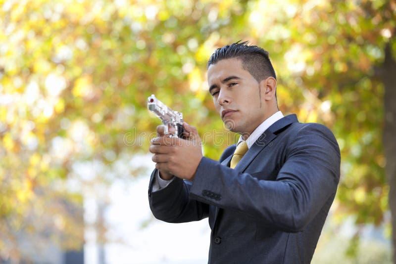 обеспеченность личного огнестрельного оружия бизнесмена стоковые изображения