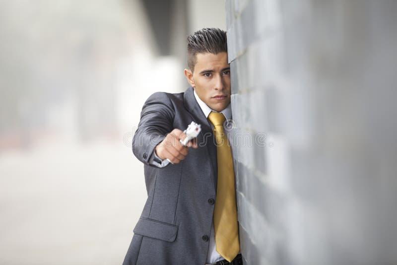 обеспеченность личного огнестрельного оружия бизнесмена стоковая фотография